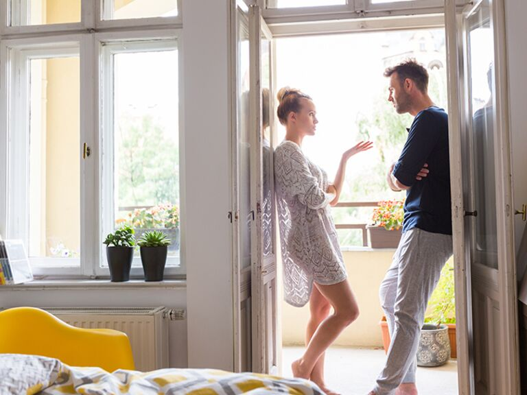 Newlywed couple having conversation in apartment.