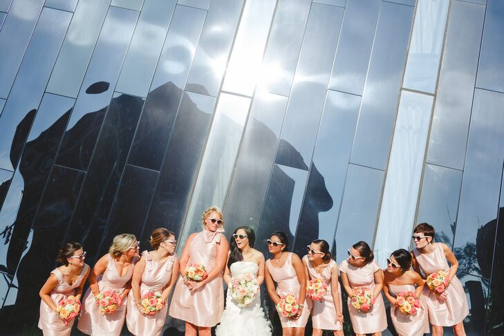 "The bridesmaids wore blush dresses in a variety of styles. ""I wanted to go for that iconic, retro cocktail party look, so I chose a few different styles in that aesthetic from Alfred Sung's collection, and let the girls individually choose the dress they liked best,"" says Shawn."