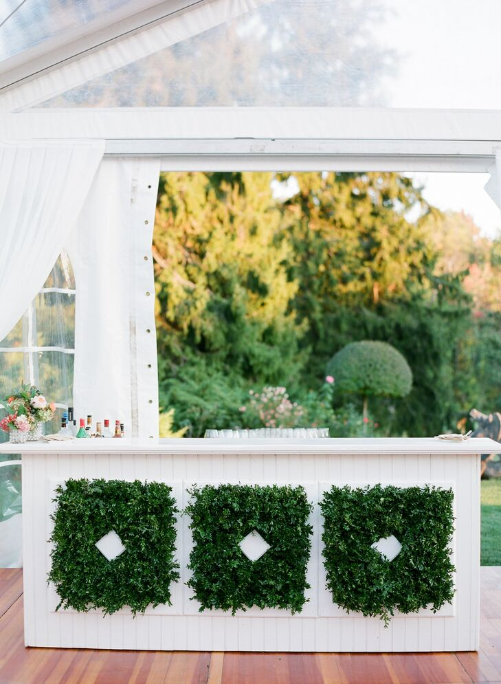 A customized bar with lush boxwood arrangements was set up on the terrace, where guests drank champagne and signature cocktails while taking in the  perfectly manicured gardens of the Wheatleigh in Lenox, Massachusetts.