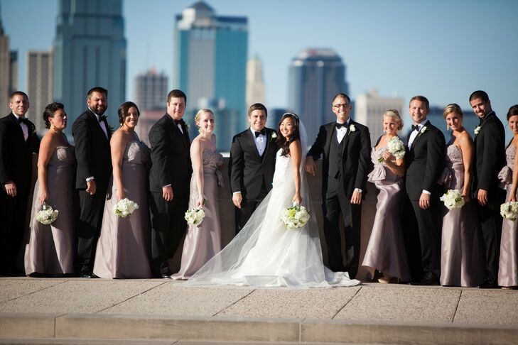 The wedding party attire was formal and elegant, with the groomsmen in contemporary black tuxedos and the bridesmaids in floor-length taupe gowns.