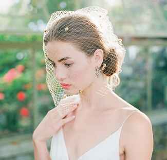 bride with birdcage veil and coral lipstick