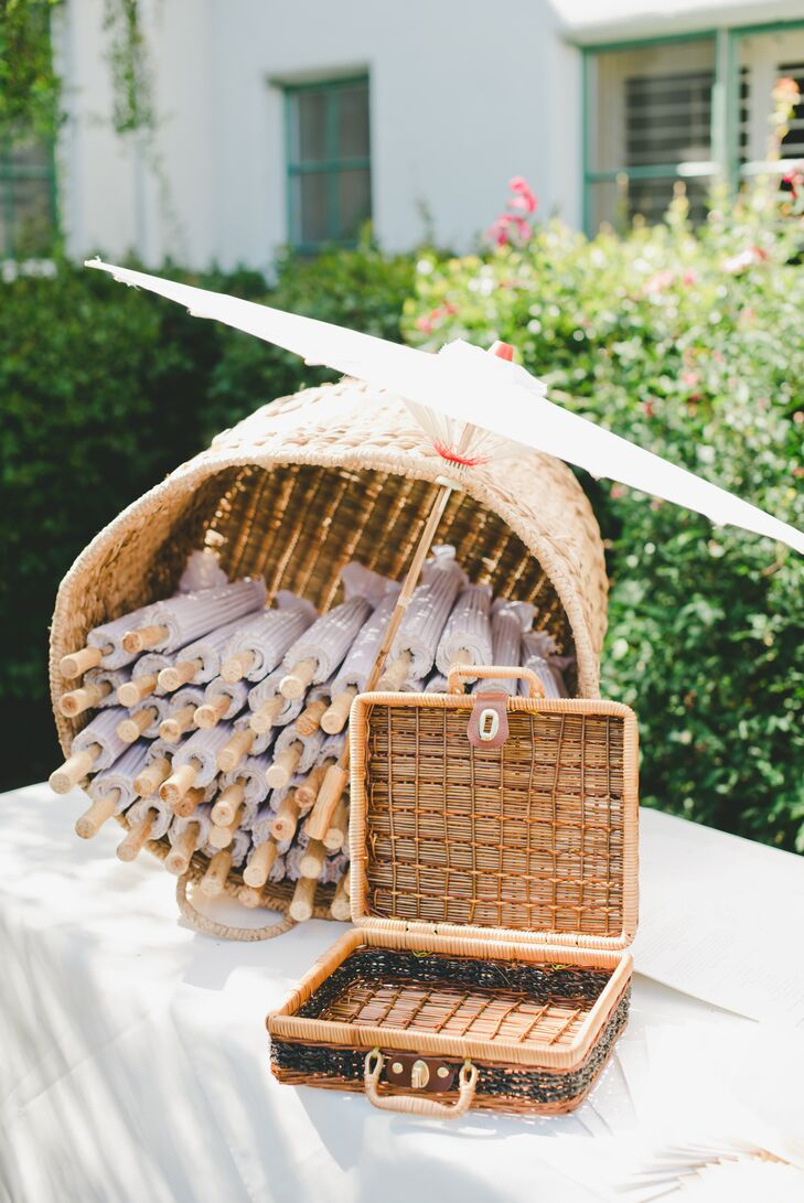 A basket of parasols sat at the entrance to the ceremony, to protect against the July sun.