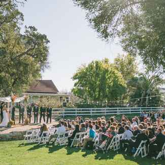 Guests attending an outdoor wedding