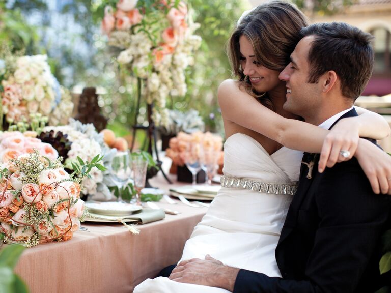 Bride and groom at lush reception table