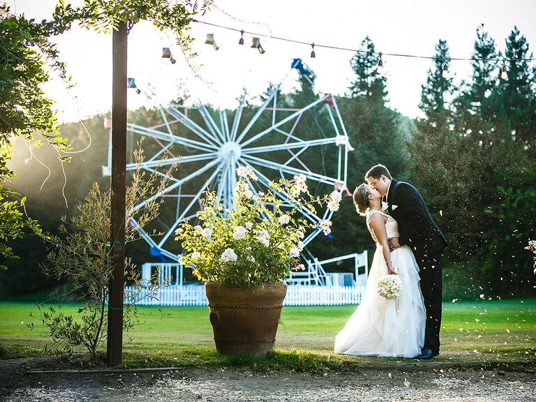 Wedding photo by ferris wheel at Calamingos Ranch