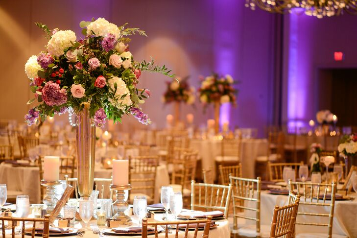 tall gold centerpiece with purple and white flowers