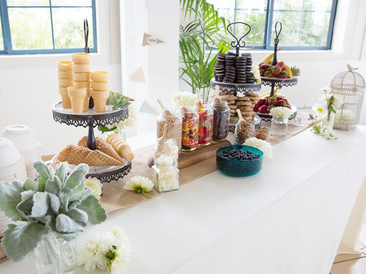 Make-your-own sundae bar at an indoor wedding reception