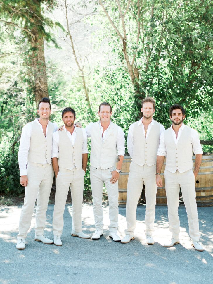 Keeping 10 groomsmen in check was no small task, but Haley had a knack for it, according to Tyler, who admits he didn't want to deal with ordering their outfits. The groomsmen stuck to a neutral color scheme for their matching vests, linen pants and suede shoes.