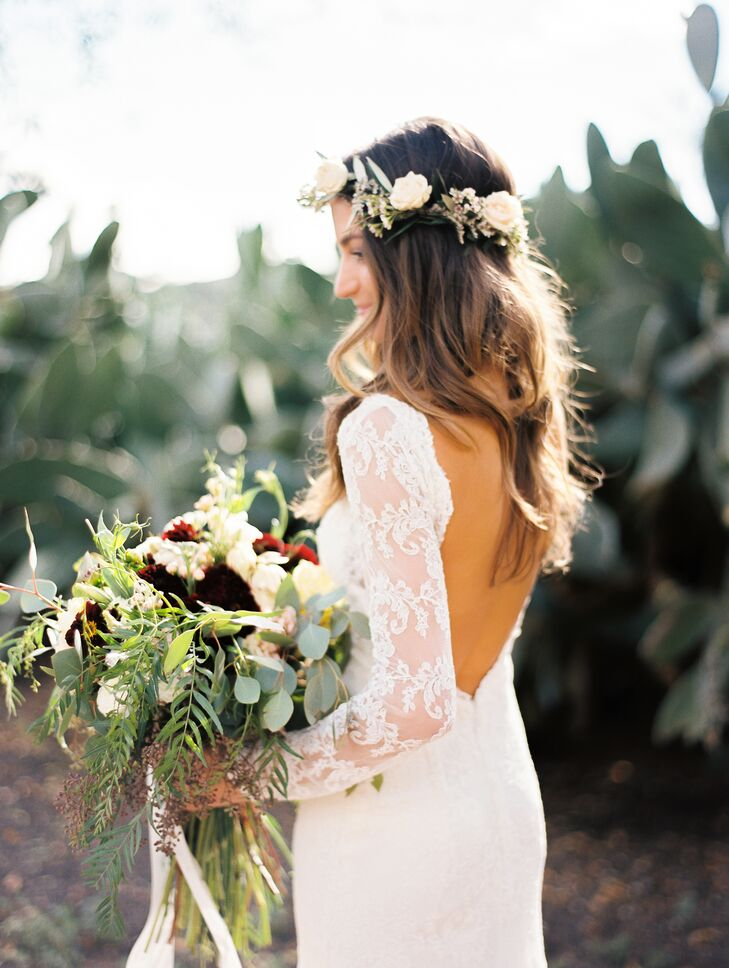 """I chose a Willowby by Watters gown that I loved and added sleeves made from extra lace to make it my own,"" Julie says. PJB Designs crafted the garden-fresh bouquet."