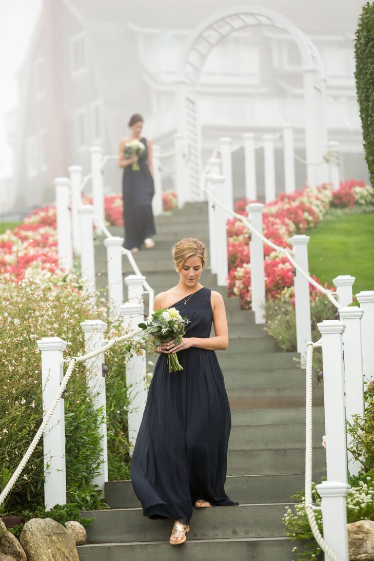 For a cohesive, elegant look, Alexandria had her bridesmaids wear the same navy, chiffon gown in an one-shoulder A.-Line silhouette.