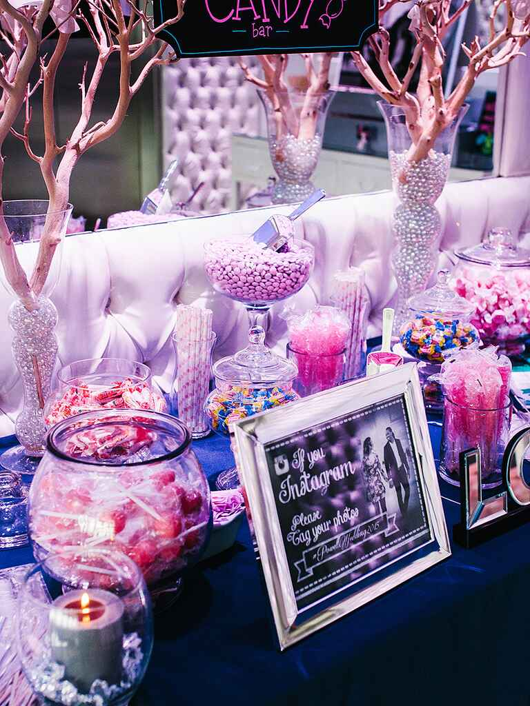 Glam purple and pink wedding reception candy bar