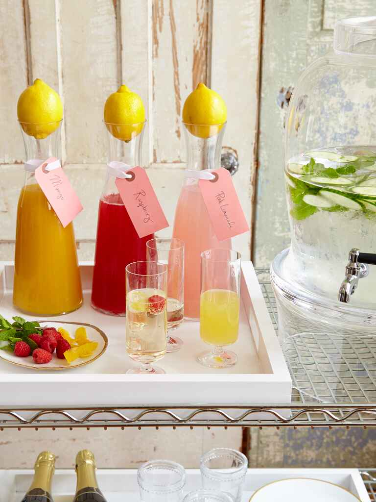 DIY champagne bar with carafes of juice