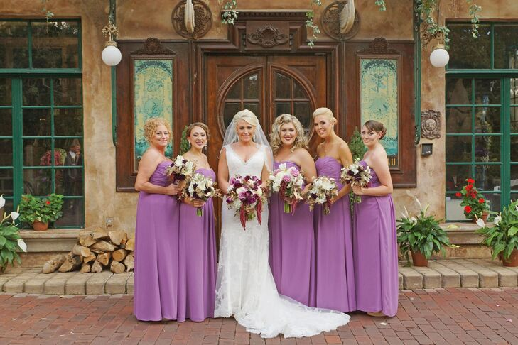 Stephanie's bridesmaids wore strapless lavender dresses with purple sapphire necklaces. They carried purple, white and gold bouquets to match the palette.