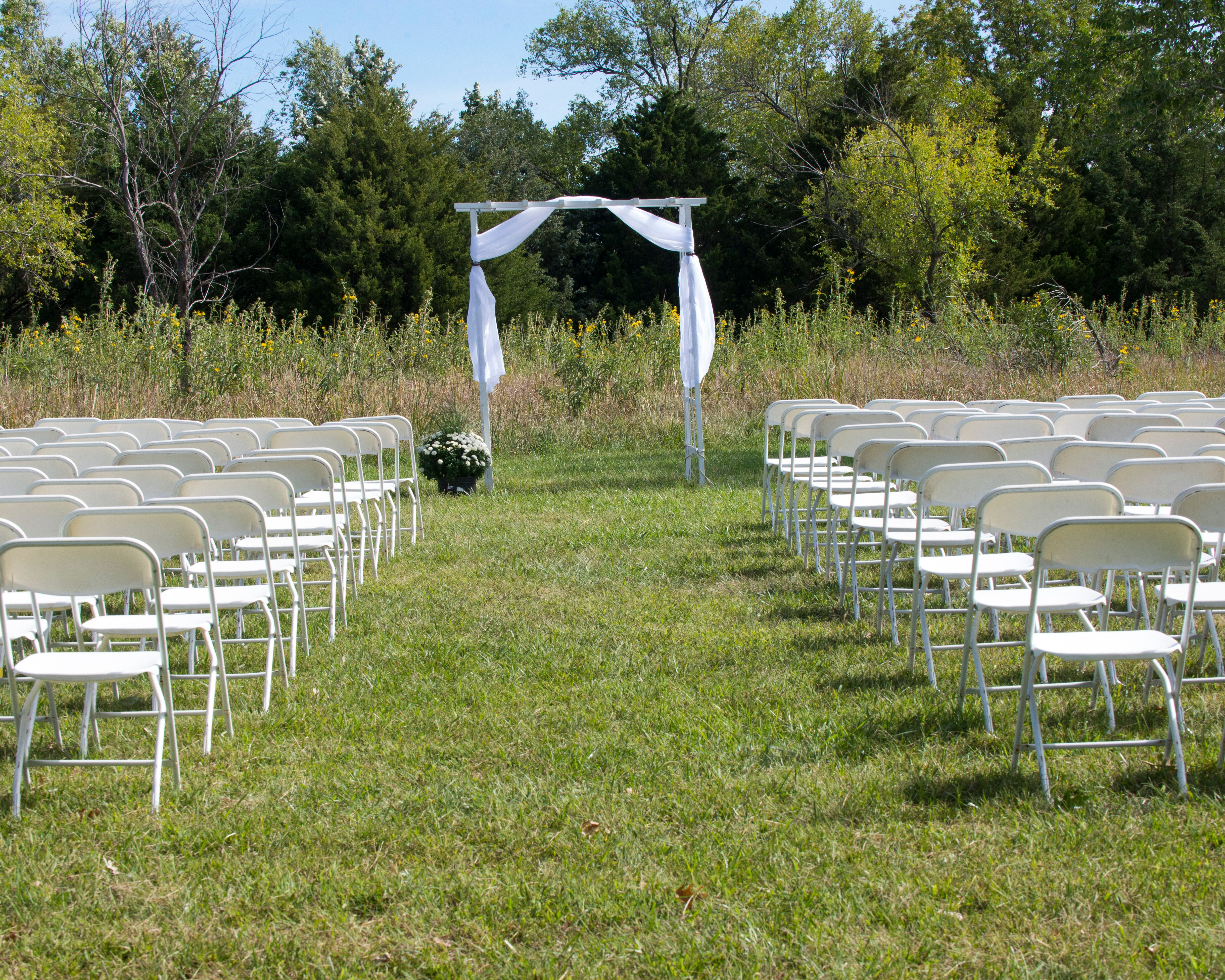 Simple White Wedding Arbor At Outdoor Ceremony