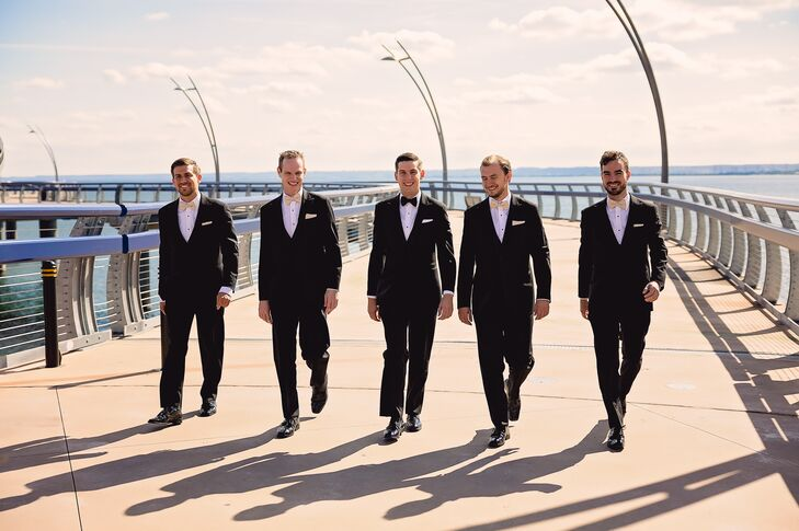 The groomsmen wore classic tuxedos from Tip Top Taylor. Piotr wore a black bow tie, while his groomsmen wore champagne bow ties.