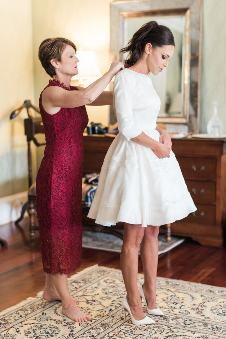 """My look for the wedding was so fun,"" says Layne, who chose a nontraditional knee-length dress by Delphine Manivet. ""It was the perfect mix of classy and fun. I opted out of a veil and instead invested in some snazzy shoes."" Layne's pointed-toe ""So Kate"" Louis Vuittons in white leather paired perfectly with the dress."