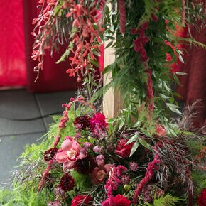 Burgundy Kangaroo Paw And Orchid Flower Arrangement With Ferns