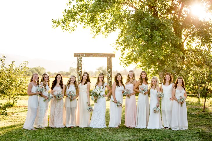 "Leslie let her 11 bridesmaids wear whatever made them comfortable for the rustic farm wedding. She asked them to find a casual maxi dress in a light neutral color. ""They all did an amazing job finding the perfect dresses,"" Leslie says. ""I'm so happy with the way they looked together."" Each of the ladies completed their look with simple jewelry, soft curls and sandals."