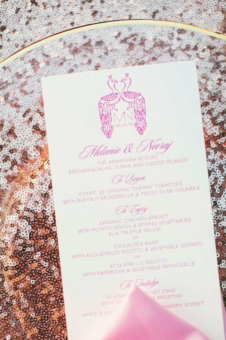 The couple's custom peacock monogram was printed in pink letterpress at the top of their menu cards. The peacock holds special meaning in Hindu culture, representing kindness and luck.