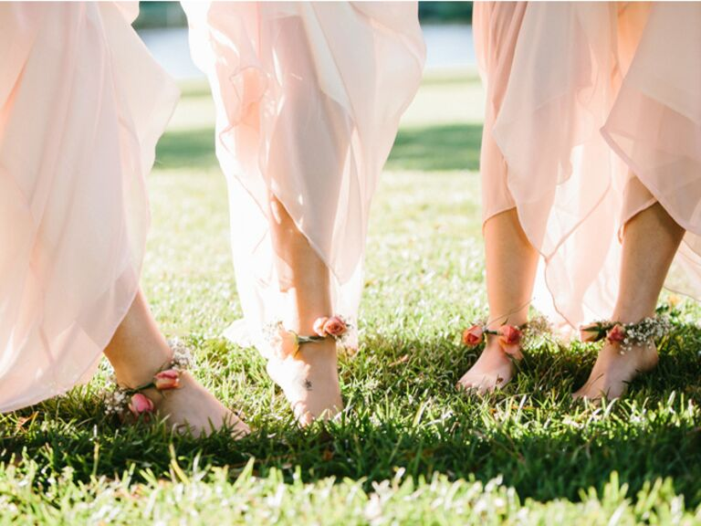 Blush bridesmaid dresses with flower anklets.