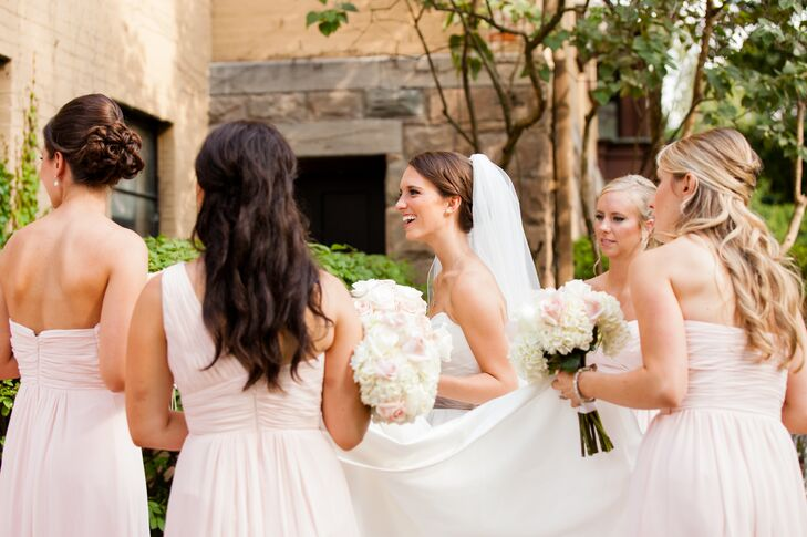 Allison's bridesmaids wore pink Bill Levkoff bridesmaid dresses with pink and white bridesmaid bouquets.