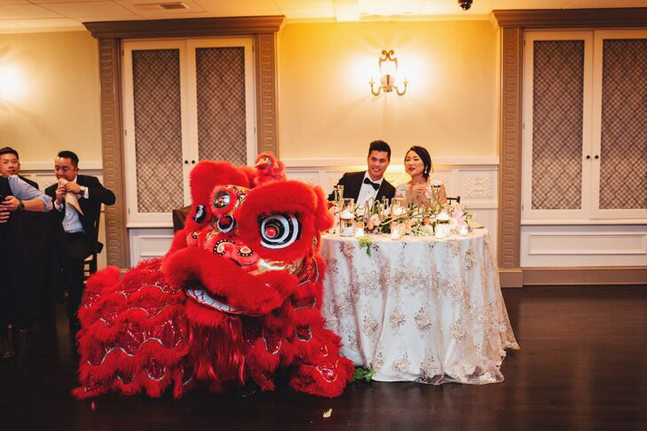 Yan and Stephen paid tribute to their Chinese roots during the reception with a traditional lion dance. The dance is traditionally performed during the reception as a blessing bestowed upon the newlyweds. During the dance, the lion presents the couple with gifts, such as oranges to represent prosperity and bamboo to symbolize strength and fertility.