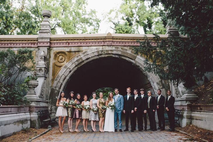 The bridesmaids wore dresses in mixed metallics, and the groomsmen wore slim fit black suits with gold metallic ties.