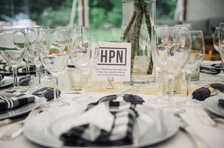 Table set with glasses and linens with flight attendant table name