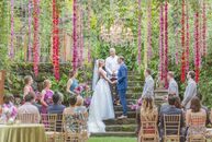 "Morgan	Smith and Nic Frazer traveled to Hawaii for a rustic, eclectic destination wedding at Haiku Mill. ""The old-world European feel of the venue, co"