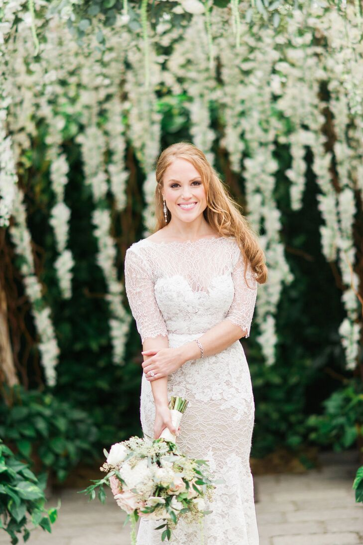 "Melissa rocked a form-fitting, ivory Watters dress complete with Chantilly lace and a nude silk slip underneath. ""I didn't give the dress much attention at first since it didn't look like much on the hanger,"" she says. ""It fit beautifully and didn't overwhelm my short, but curvy frame."""