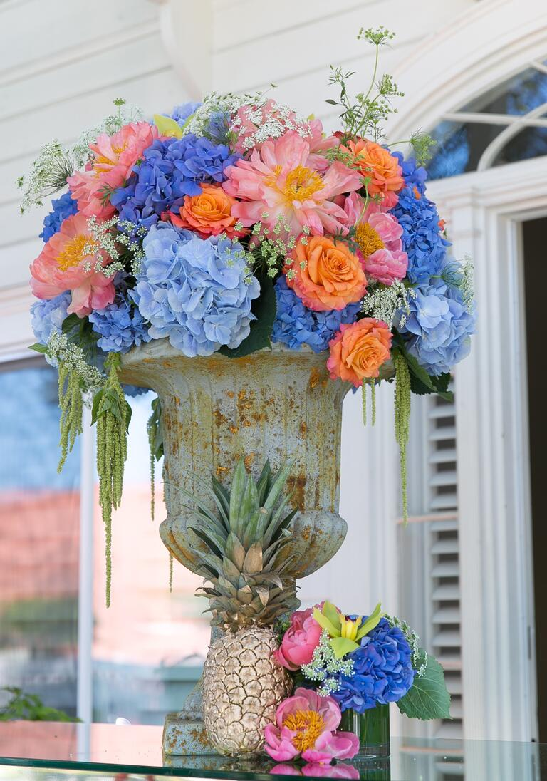 Antique vase with colorful peonies, roses and hydrangeas