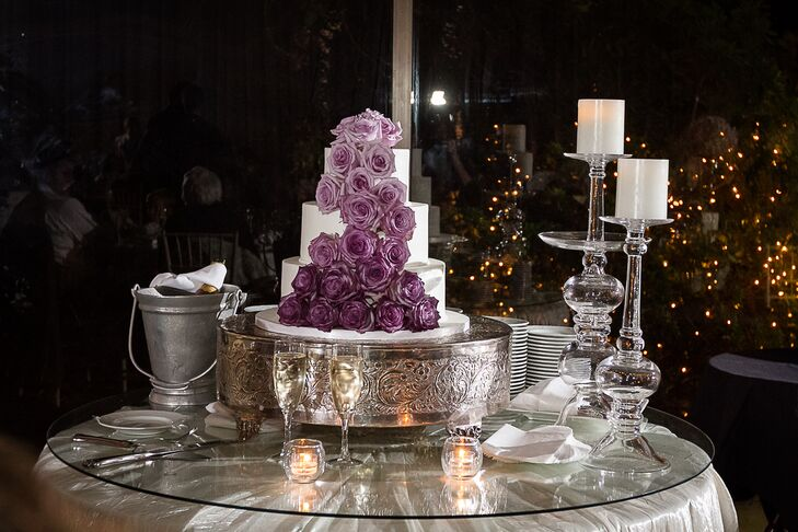 The decor highlight? Definitely the wedding cake. Daniel and Jamie showed the bakers at A Divine Event what they wanted, and were so pleased with the result: It had three round tiers with a purple ombre cascade of fresh roses down the front.