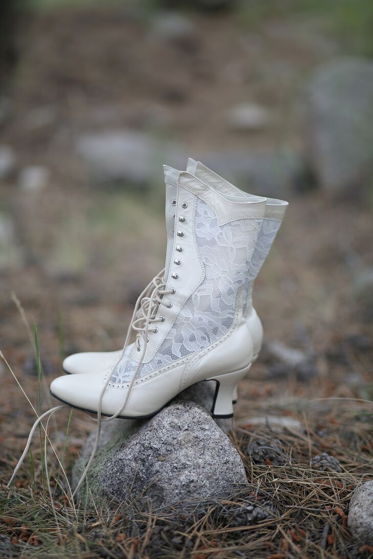 In keeping with the vintage Victorian western theme, Becky wore white lace booties with her empire waist Wtoo wedding dress. The gorgeous lace on the booties perfectly complemented the lace dress and the lace cap sleeves she added on too.