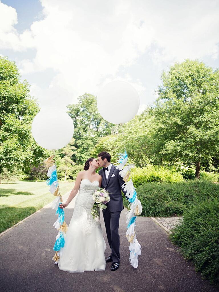Giant white balloons with blue and gold tassels