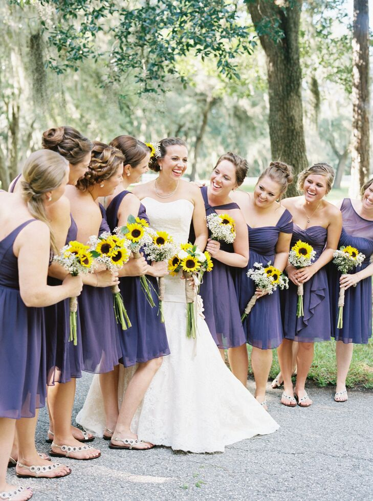 Bridesmaids in matching plum dresses for Sunflower dresses for wedding