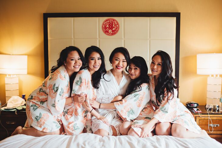 Before the day's festivities kicked into high gear, Yan got ready with her girlfriends at a nearby hotel. As a thank-you, she gave each a floral satin robe, which they all wore while primping and pampering for their walk down the aisle.