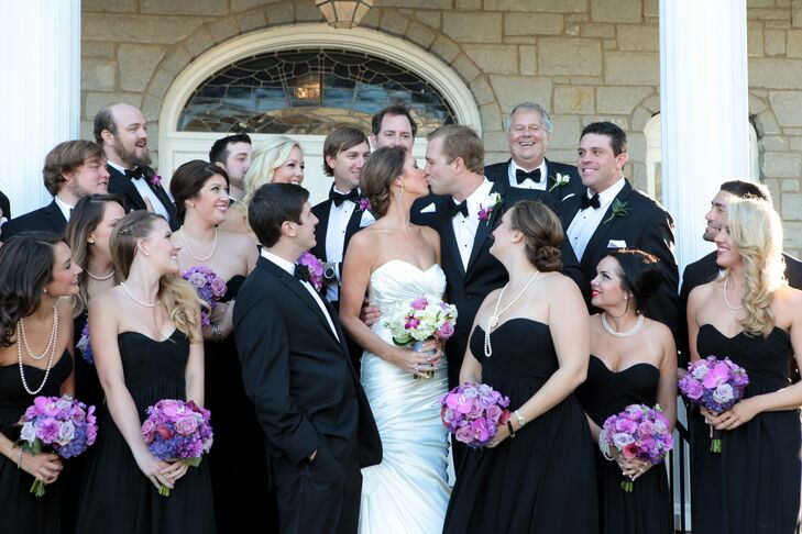 The wedding party set a formal tone with black tuxedos and black strapless gowns.