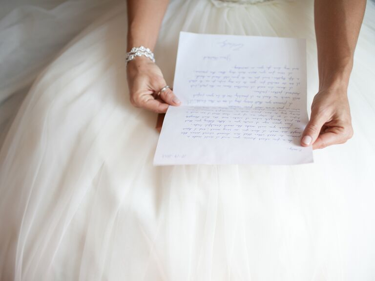 Bride reading groom's note before ceremony