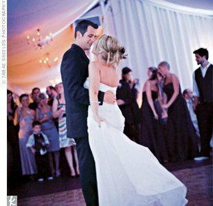 Alli and Jeff took to the dance floor for the first time as a married couple to Bless the Broken Road, by Rascal Flatts.