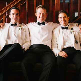 Groom and groomsmen in tuxedos