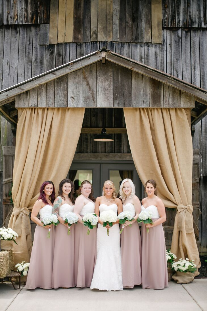 Katharine's bridesmaids wore two-tone maxi dresses with an ivory bodice and taupe skirts. The dresses looked beautiful on each bridesmaid, and what's more, they matched the sash on Katharine's wedding dress and the barn drapery.