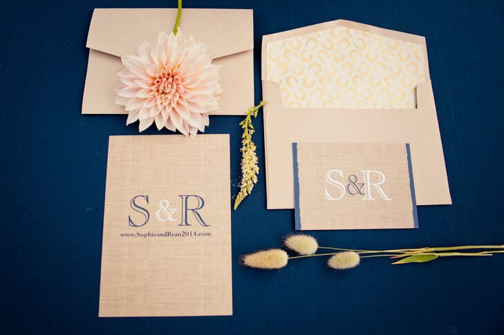 Wedding invitations were printed on burlap-patterned stationery, decorated with white and dark blue accents, to fit the shabby-chic look of the wedding at Rancho Soquel in Santa Cruz, California.