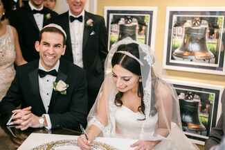 Signing a marriage certificate