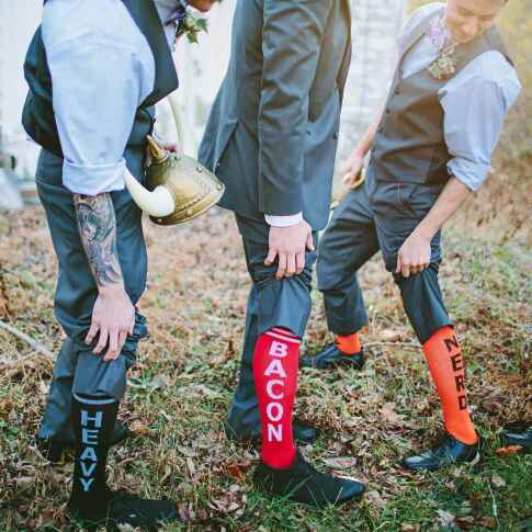 Groomsmen wearing bacon socks