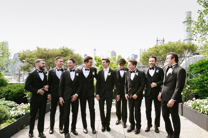 """I wanted all the boys to look sharp and dapper, and because there were so many of them, I knew that the safest option was a black tux,"" Sasha says of the classic groomsmen attire."