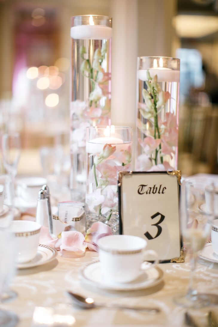Floating Candle Centerpieces With Blush Orchids And Rose Gold Table
