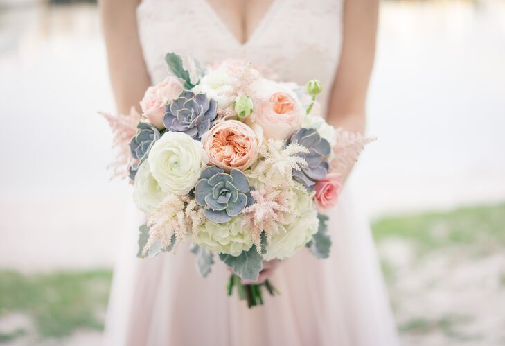 """One flower I fell in love with early on was peach-colored astilbe, which established peach and blush as colors,"" Lindsey says. Her bouquet from Libby's Flowers was filled with white and pink astilbe, blush garden roses, white hydrangeas, white ranunculus, pink roses, dusty miller and succulents for some extra texture."
