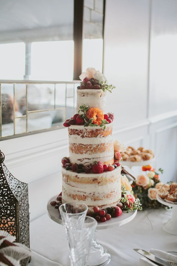 Beach wedding cakes colorful naked cake with orange blossoms and fruit junglespirit Image collections