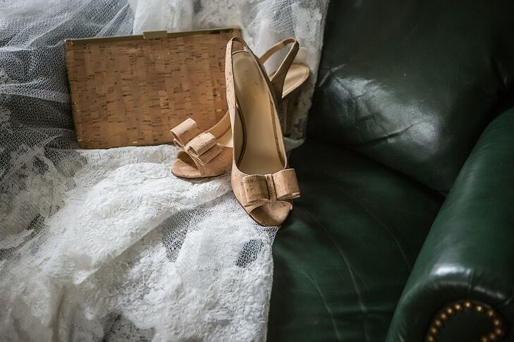 In keeping with the wedding's wine theme, Jaymie wore cork-bow peep-toe heels by Kate Spade. She also carried a matching clutch.