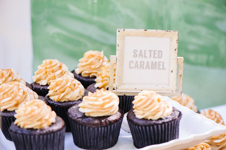 """We are both obsessed with cupcakes so they had to be there in lieu of a traditional cake,"" explains Sean. The couple served  several different gourmet flavors like salted caramel, strawberry shortcake, etc."